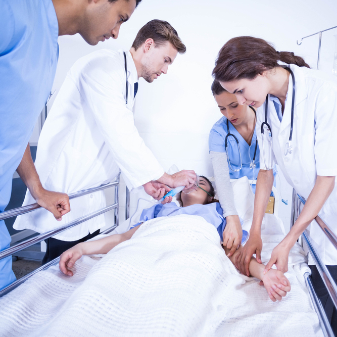 doctors working on femail patient