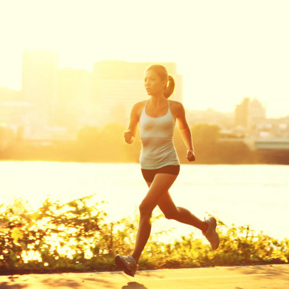 Healthy woman running at sunset to stay fit during locums assignment